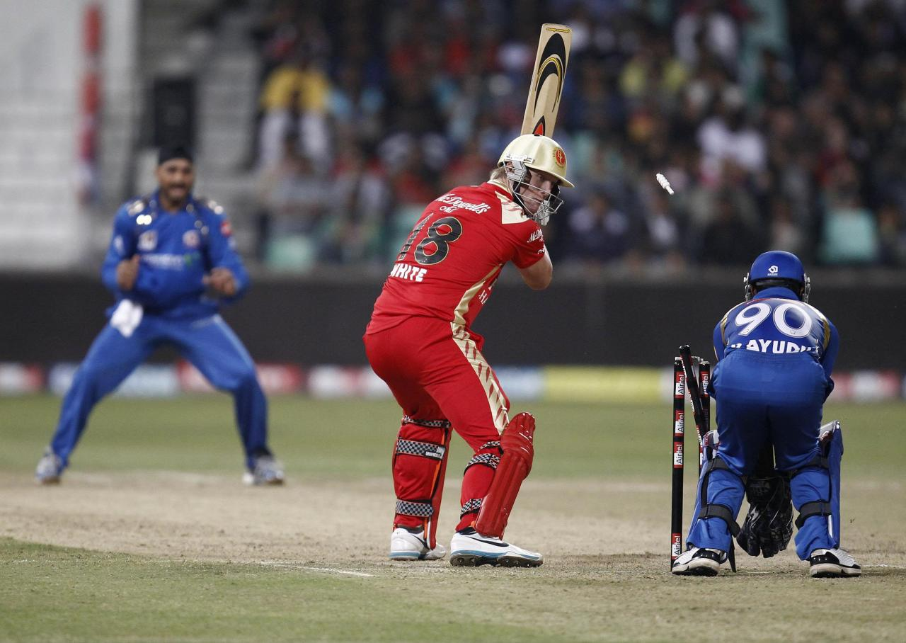 DURBAN, SOUTH AFRICA - SEPTEMBER 19: Cameron White of the Royal Challengers Bangalore is bowled by Harbhajan Singh of the Mumbai Indians during the Airtel Champions League Twenty20 match between Mumbai Indians and Royal Challengers Bangalore at Sahara Stadium Kingsmead on September 19, 2010 in Durban, South Africa. (Photo by Anesh Debiky/Gallo Images/Getty Images)