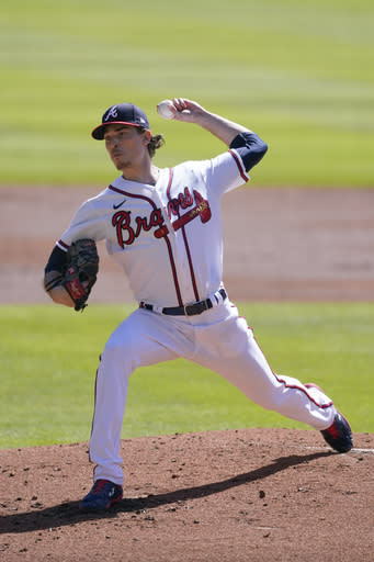 Atlanta Braves starting pitcher Max Fried (54) works in second inning during Game 1 of a National League wild-card baseball series between the Atlanta Braves and the Cincinnati Reds, Wednesday, Sept. 30, 2020, in Atlanta. (AP Photo/John Bazemore)