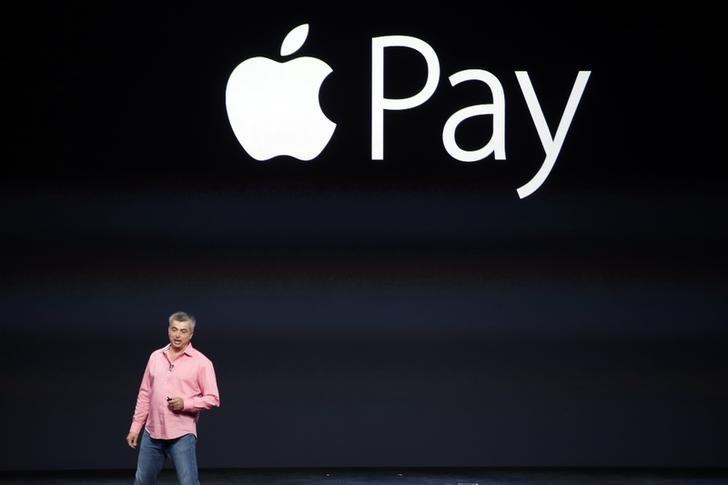 Eddy Cue, Apple's senior vice president of Internet Software and Service, introduces Apple Pay during an Apple event at the Flint Center in Cupertino