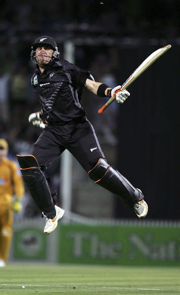HAMILTON, NEW ZEALAND - FEBRUARY 20:  Brendan McCullum of New Zealand leaps in the air after hitting the winning runs during the third one-day international match of the Chappell-Hadlee Trophy series between New Zealand and Australia at Seddon Park on February 20, 2007 in Hamilton, New Zealand.  (Photo by Ross Land/Getty Images) *** Local Caption *** Brendan McCullum