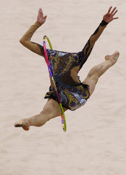 Son Yeon-jae of South Korea competes in the individual all around rhythmic gymnastics final at the 16th Asian Games in Guangzhou, Guangdong province, November 26, 2010. (REUTERS/David Gray)