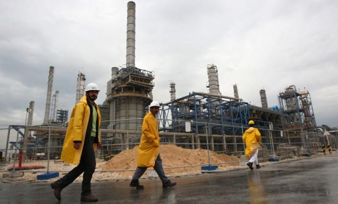Workers walk through the South Pars gas filed in Assalouyeh, Iran, Jan. 27, 2011.