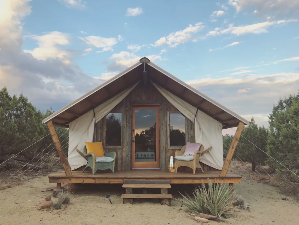 "<h3><a href=""https://www.airbnb.com/rooms/16497200"" rel=""nofollow noopener"" target=""_blank"" data-ylk=""slk:Juniper's Tent - Desert Glamping"" class=""link rapid-noclick-resp"">Juniper's Tent - Desert Glamping</a></h3> <br>""A spacious, comfortable and stylish off-the-grid escape to immerse yourself in the outdoors while staying comfortable indoors. Glorified camping, a perfect romantic getaway.""<br><br><strong>Location: </strong>Cortez, Colorado<br><strong>Sleeps: </strong>2<br><strong>Price Per Night: </strong>$105<span class=""copyright"">Photo: Courtesy of Airbnb.</span><br><br><br><br><br>"
