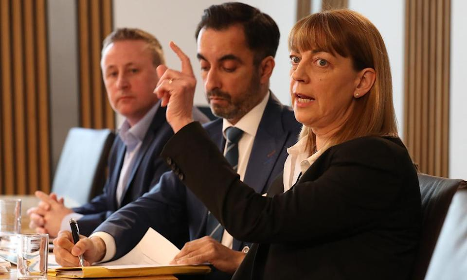 Linda and Stuart Allan and their lawyer, Aamer Anwar