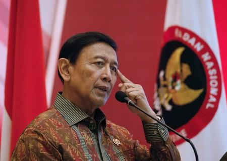 Indonesia Chief Security Minister Wiranto delivers a speech during a meeting between former militants and victims in Jakarta