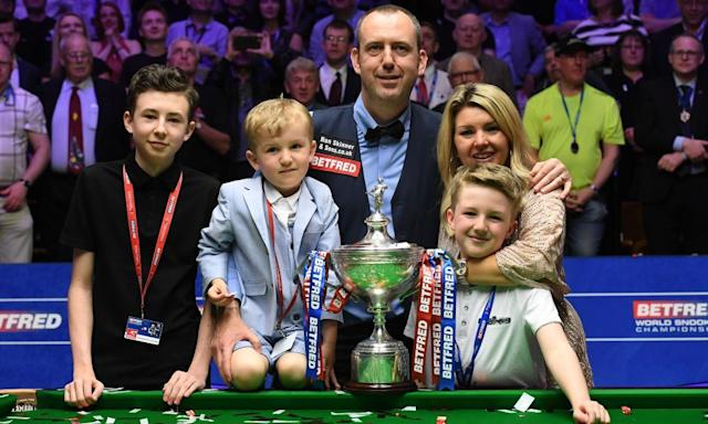 """<span class=""""element-image__caption"""">Mark Williams celebrates with the trophy and his family after winning his third World Snooker Championship title 15 years after his second.</span> <span class=""""element-image__credit"""">Photograph: Anna Gowthorpe/BPI/REX/Shutterstock</span>"""