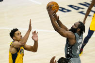 Brooklyn Nets guard James Harden (13) shoots over Indiana Pacers guard Malcolm Brogdon (7) during the second half of an NBA basketball game in Indianapolis, Wednesday, March 17, 2021. (AP Photo/Michael Conroy)