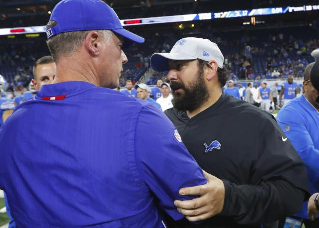 Detroit Lions head coach Matt Patricia, right, meets with New York Giants head coach Pat Shurmur after their team's preseason NFL football game, Friday, Aug. 17, 2018, in Detroit. (AP Photo/Paul Sancya)