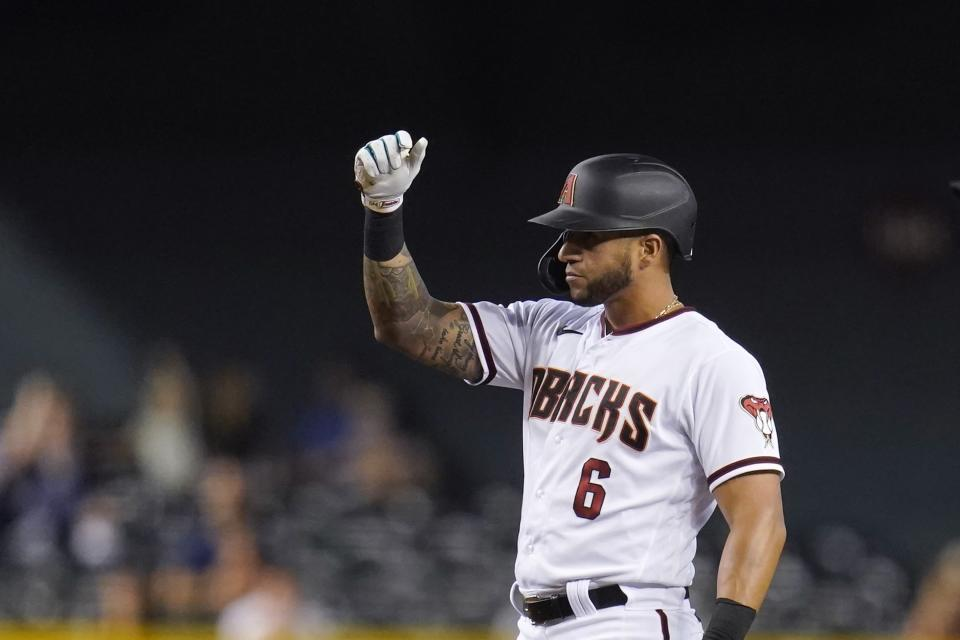 Arizona Diamondbacks' David Peralta celebrates his double against the Miami Marlins during the fifth inning of a baseball game Monday, May 10, 2021, in Phoenix. (AP Photo/Ross D. Franklin)