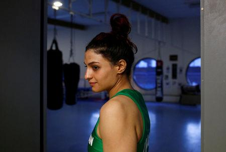 FILE PHOTO: Iranian boxer Sadaf Khadem looks on before her fight against French boxer Anne Chauvin during an official boxing bout in Royan, France, April 13, 2019. REUTERS/Stephane Mahe/File Photo
