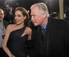 Angelina Jolie and Jon Voight talk to press at the 'In the Land of Blood and Honey' premiere held at ArcLight Cinemas in Hollywood on December 8, 2011  -- WireImage