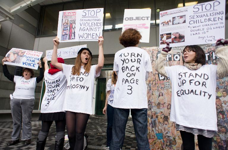 Campaigners from OBJECT and Turn Your Back On Page 3 protest over the Sun newspaper's daily photos of topless female models outside the UK offices of News International in east London on November 17, 2012 (AFP Photo/Leon Neal)