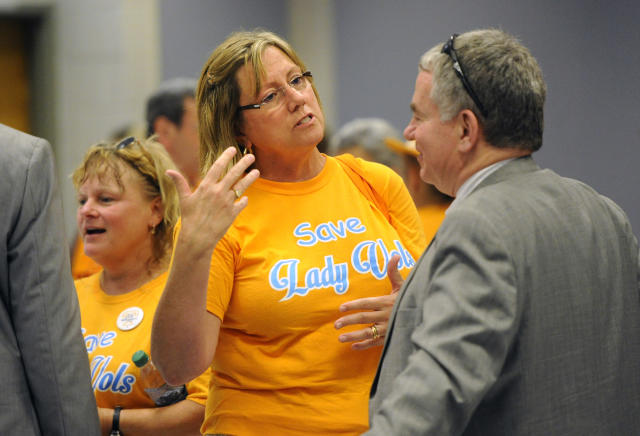 Former Tennessee Lady Vols swimmer Mollie DeLozier, center, talks with James Murphy, University of Tennessee Board of Trustees vice chair, following the board's annual meeting at Hollingsworth Auditorium, Thursday, June 25, 2015, in Knoxville, Tenn. The board did not address the issue of the Lady Vols nickname as the university prepares to eliminate the nickname and logo for all women's sports other than basketball. (Adam Lau/Knoxville News Sentinel via AP)