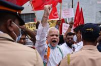Members of the Indian National Congress (INC) political party protest against farm laws during a nationwide strike, in Mumbai