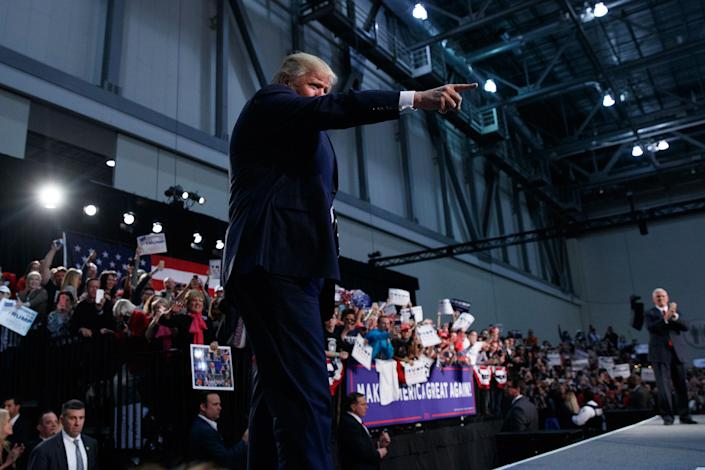 <p>Republican presidential candidate Donald Trump points to the crowd as he arrives to speak to a campaign rally, Tuesday, Nov. 8, 2016, in Grand Rapids, Mich. (Photo: Evan Vucci/AP) </p>
