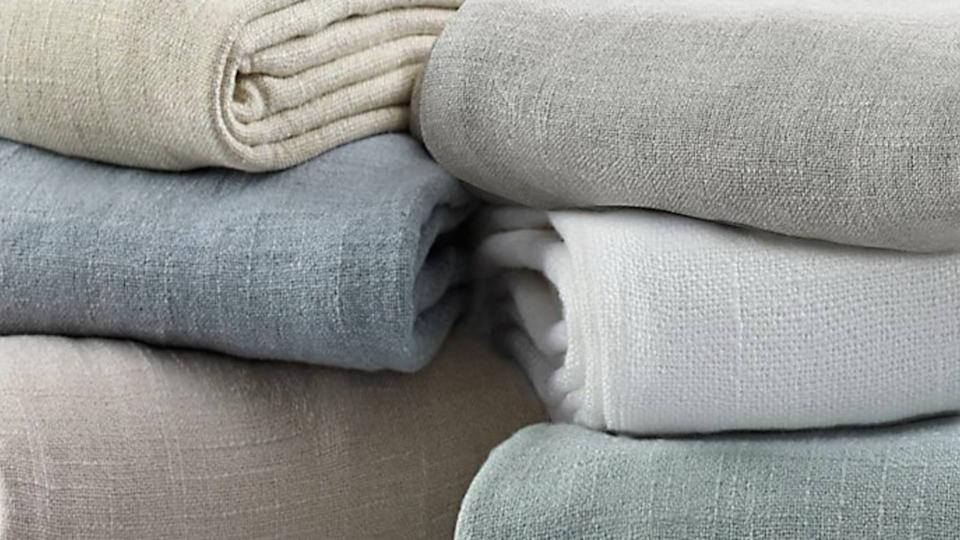 Soft throws in sophisticated tones, at 74 percent off. Snap them up fast for gifts before they're all gone. (Photo: Bed Bath & Beyond)