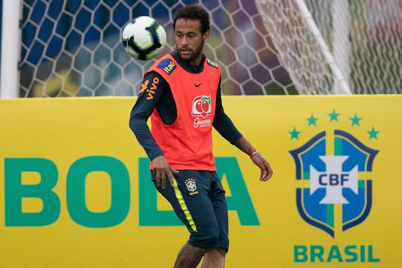 ea9e6c46584 Brazil's soccer player Neymar controls the ball during a practice session  at the Granja Comary training