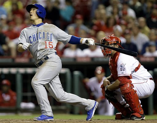 Chicago Cubs' Darwin Barney (15) hits a solo home run off Cincinnati Reds relief pitcher Manny Parra in the 10th inning of a baseball game, Tuesday, April 23, 2013, in Cincinnati. Corky Miller catches at right. Chicago won 4-2 in 10 innings. (AP Photo/Al Behrman)
