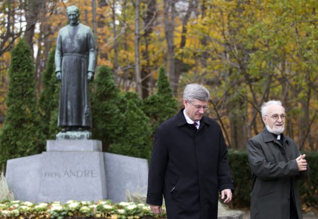 Father Claude Grou, right, walks with Prime Minister Stephen Harper on Oct. 30, 2010 during a tour of Saint Joseph's Oratory in Montreal.