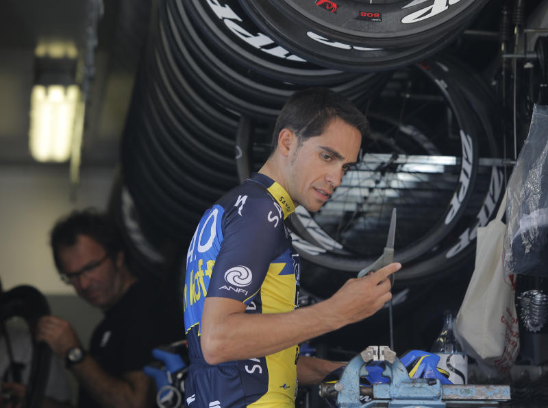 Spain's Alberto Contador, right, prepares to leave for a training ride in Porto Vecchio, southern Corsica island, France, Thursday June 27, 2013. The Tour de France cycling race starts in Porto Vecchio on Saturday June 29, and the 198-rider peloton, or pack, is to cover 3,479 kilometers (2,162 miles) over three weeks, 21 stages and two rest days, before an unusual nighttime finish July 21 on the Champs-Elysees in Paris. (AP Photo/Laurent Cipriani)