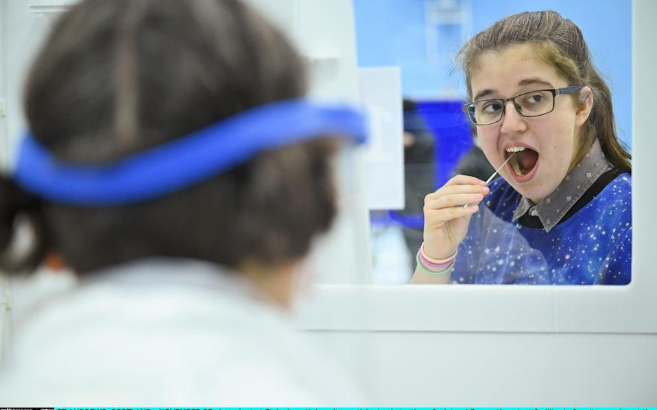 A student at St Andrew University at a lateral flow antigen test facility -  Jeff J Mitchell/Getty Images