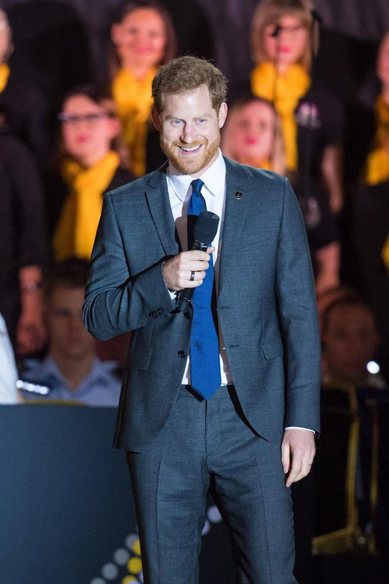 Prince Harry speaks onstage at the opening of the competition (PA)