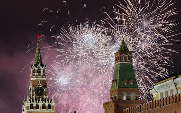 Fireworks light the night sky over the Kremlin and the Red square to mark the New Year in Moscow - REX