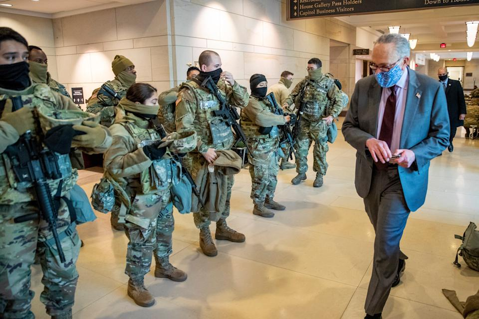 Senate Majority Leader Chuck Schumer greets National Guard soldiers (EPA)