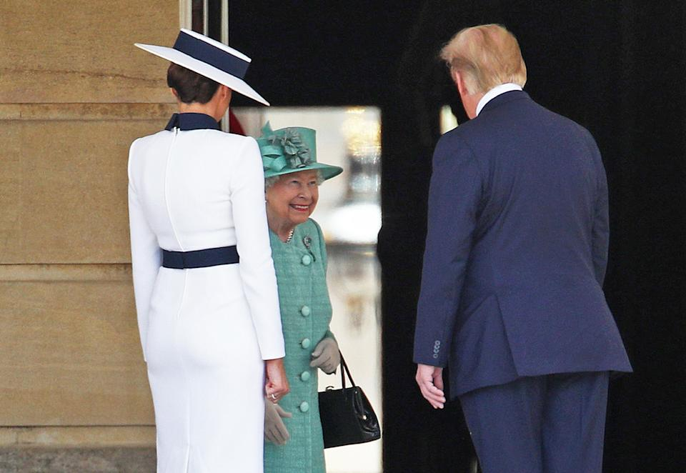 All smiles: US President Donald Trump and his wife Melania are welcomed by Queen Elizabeth II during the Ceremonial Welcome at Buckingham Palace. (Yui Mok/PA Images via Getty Images)