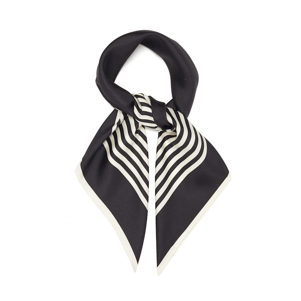"""This graphic scarf will keep her feeling chic, even in three-day-old <a href=""""https://www.glamour.com/gallery/best-black-leggings-to-buy-now?mbid=synd_yahoo_rss"""" rel=""""nofollow noopener"""" target=""""_blank"""" data-ylk=""""slk:leggings"""" class=""""link rapid-noclick-resp"""">leggings</a>. $86, MatchesFashion. <a href=""""https://www.matchesfashion.com/us/products/Lescarf-No-2-striped-silk-twill-scarf-1386628"""" rel=""""nofollow noopener"""" target=""""_blank"""" data-ylk=""""slk:Get it now!"""" class=""""link rapid-noclick-resp"""">Get it now!</a>"""