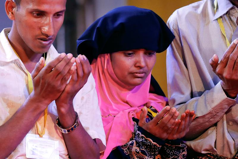 Tears run down the face of awomanas she and others pray during their meeting with Pope Francis in Dhaka, Bangladesh, on Dec. 1. (Damir Sagolj / Reuters)