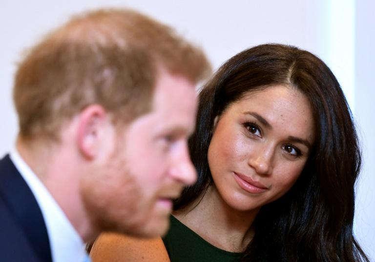 Britain's Prince Harry, Duke of Sussex (L) and Meghan, Duchess of Sussex are pictured in October 2019