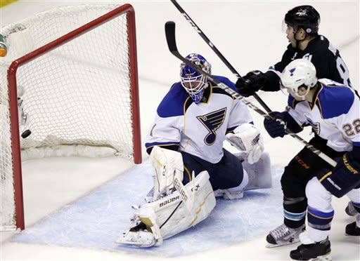San Jose Sharks defenseman Brent Burns (88) scores past St. Louis Blues goalie Brian Elliott (1) and defenseman Kevin Shattenkirk (22) during the first period in Game 3 of an NHL Stanley Cup first-round hockey playoff series, Monday, April 16, 2012 in San Jose, Calif. (AP Photo/Paul Sakuma)