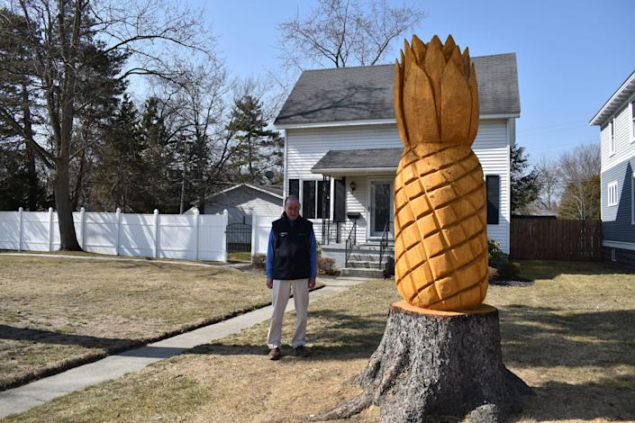"""The tree sculpture is now listed on Google maps as """"Port Huron Pineapple stature,"""" and visitors and people throughout town refer to it as """"the Pineapple house."""""""