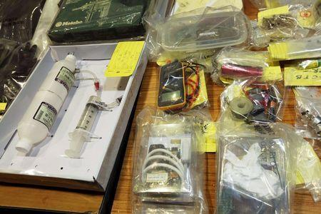 Items relating to making explosives, seized during an operation, are displayed during a news conference at police headquarters in Hong Kong, China June 15, 2015. REUTERS/Bobby Yip