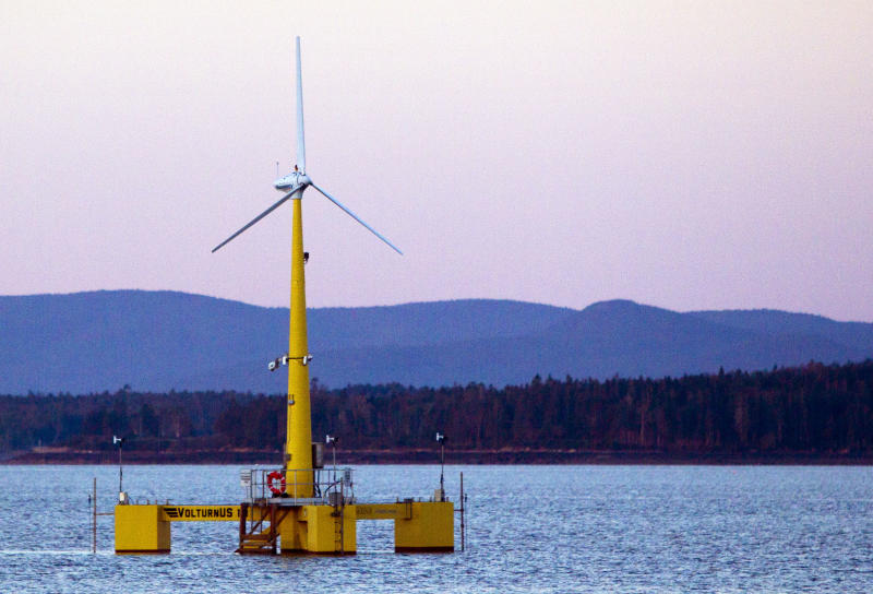 FILE - This Friday, Sept. 20, 2013 file photo shows the country's first floating wind turbine works off the coast of Castine, Maine. Oregon and federal officials are announcing a new effort to tap into offshore wind energy resources in federal waters along the West Coast. Gov. John Kitzhaber, U.S. Secretary of the Interior Sally Jewell and Bureau of Ocean Energy Management Director Tommy Beaudreau are making the announcement at a press conference Wednesday, Feb. 5, 2014. (AP Photo/Robert F. Bukaty, File)