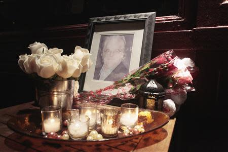 Flowers and candles are laid at a memorial for actor Philip Seymour Hoffman outside Philip Marie Restaurant and bar on Hudson Street in Manhattan, New York February 2, 2014. REUTERS/John Taggart
