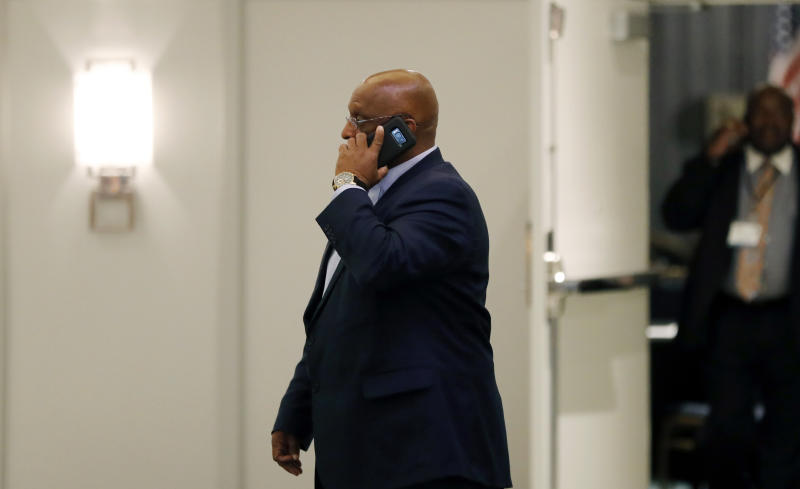 "Acting Baltimore Mayor Bernard ""Jack"" Young talks on the phone outside the National Organization of Black County Officials annual Economic Development Conference, Thursday, May 2, 2019, in Detroit. Young became acting mayor on Thursday after Mayor Catherine Pugh resigned under pressure amid a flurry of investigations into whether she arranged bulk sales of her self-published children's books to disguise hundreds of thousands of dollars in kickbacks. (AP Photo/Carlos Osorio)"