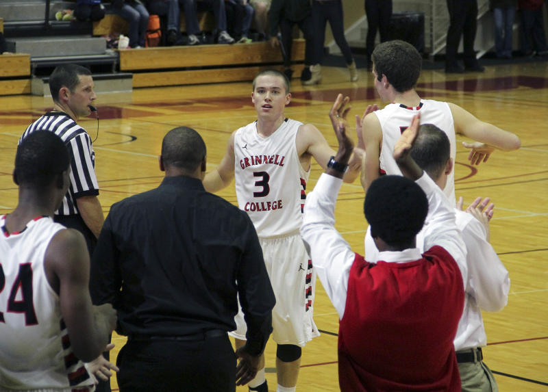 In this photo taken, Tuesday, Nov. 20, 2012, and provided by Grinnell College, Grinnell's Jack Taylor (3) is congratulated by teammates after an NCAA college basketball game against Faith Baptist Bible in Grinnell, Iowa. Taylor shattered the NCAA scoring record with 138 points, hoisting a mind-boggling 108 attempts _ or one shot every 20 seconds _ in eclipsing the previous record by 25 points. (AP Photo/Grinnell College, Cory Hall)
