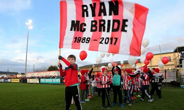"<span class=""element-image__caption"">Members of Derry City Cubs side pay tribute to the club captain, Ryan McBride, before the League of Ireland match against Bray Wanderers at Maginn Park.</span> <span class=""element-image__credit"">Photograph: Presseye/Inpho/Rex/Shutterstock</span>"
