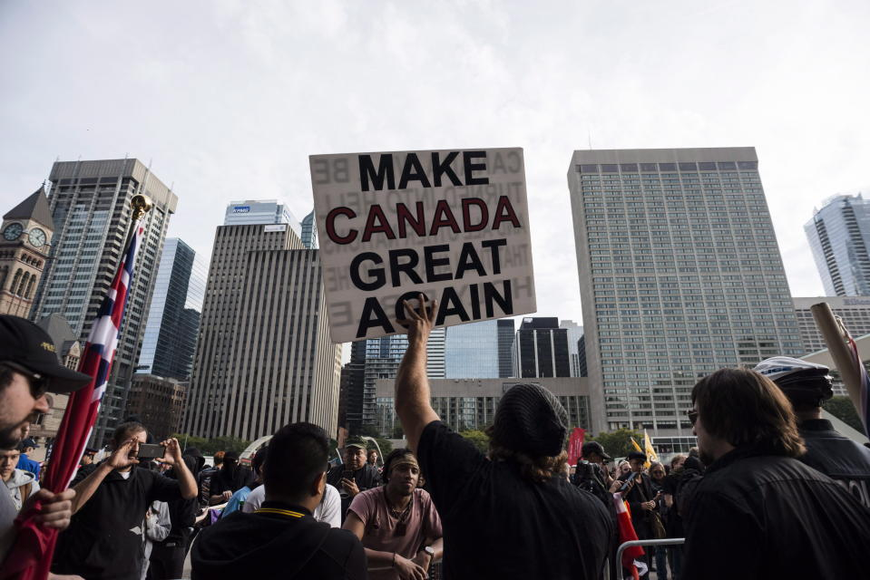Far-right and ultra-nationalist groups, including the Northern Guard, Proud Boys, and individuals wearing Soldiers of Odin patches, were among those gathered to protest the government's lawsuit settlement with Canadian torture victim Omar Khadr, at Nathan Philips Square in Toronto on Saturday, October 21, 2017. THE CANADIAN PRESS/Christopher Katsarov