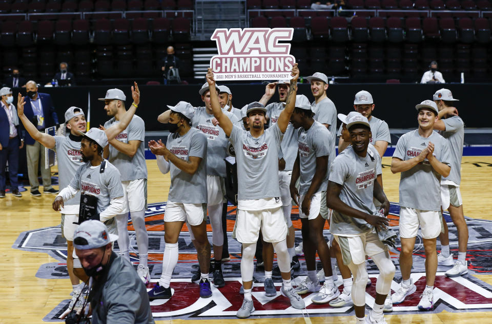 Grand Canyon players celebrate after defeating New Mexico State 74-56 in an NCAA college basketball game for the championship of the Western Athletic Conference men's tournament Saturday, March 13, 2021, in Las Vegas. (AP Photo/Chase Stevens)