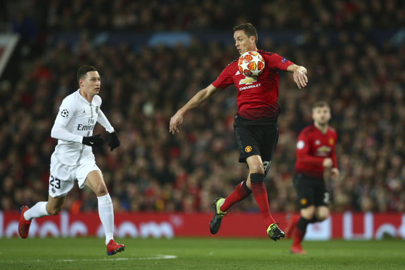 Manchester United's Nemanja Matic, controls the ball with his chest during the Champions League round of 16 soccer match between Manchester United and Paris Saint Germain at Old Trafford stadium in Manchester, England, Tuesday, Feb. 12,2019.(AP Photo/Dave Thompson)