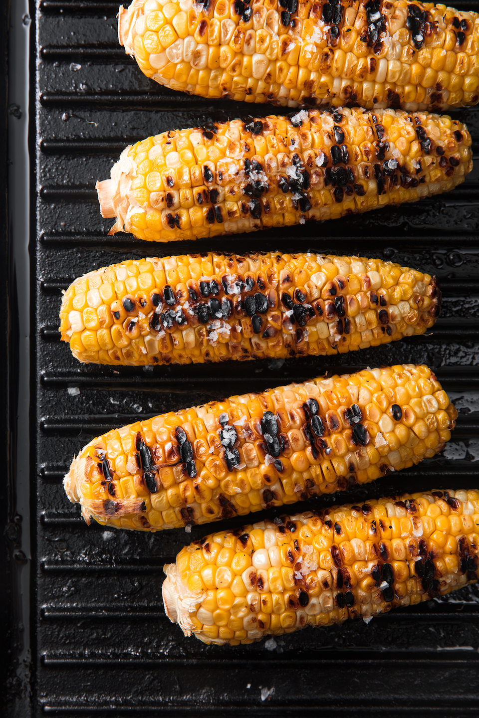 "<p>When the weather gets warm, grilled corn on the cob is basically mandatory. Sweet and crunchy with a bit of smokey char, so juicy it runs down your chin—what could be better? </p><p>Get the <a href=""https://www.delish.com/uk/cooking/recipes/a30712393/best-grilled-corn-on-the-cob-recipe/"" rel=""nofollow noopener"" target=""_blank"" data-ylk=""slk:Grilled Corn On The Cob"" class=""link rapid-noclick-resp"">Grilled Corn On The Cob</a> recipe. </p>"