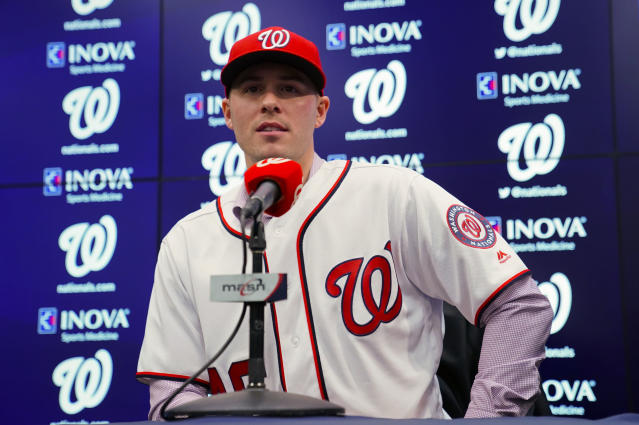 FILE - In this Dec. 7, 2018, file photo, Washington Nationals new pitcher Patrick Corbin answers questions from members of the media during a baseball news conference at Nationals Park in Washington. Spring training begins next week. (AP Photo/Pablo Martinez Monsivais, File)