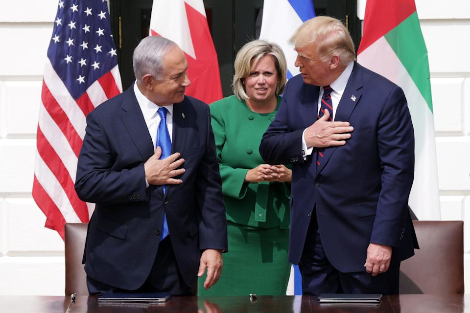 Cam Henderson (center) is the chief of protocol at the State Department, attending high-profile events like the White House ceremony in September at which Bahrain and the United Arab Emirates agreed to recognize Israel. (Photo: Alex Wong via Getty Images)
