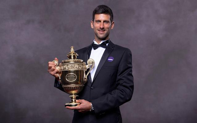 Djokovic lifted the Wimbledon trophy for the fifth time after an epic defeat of Roger Federer - AFP