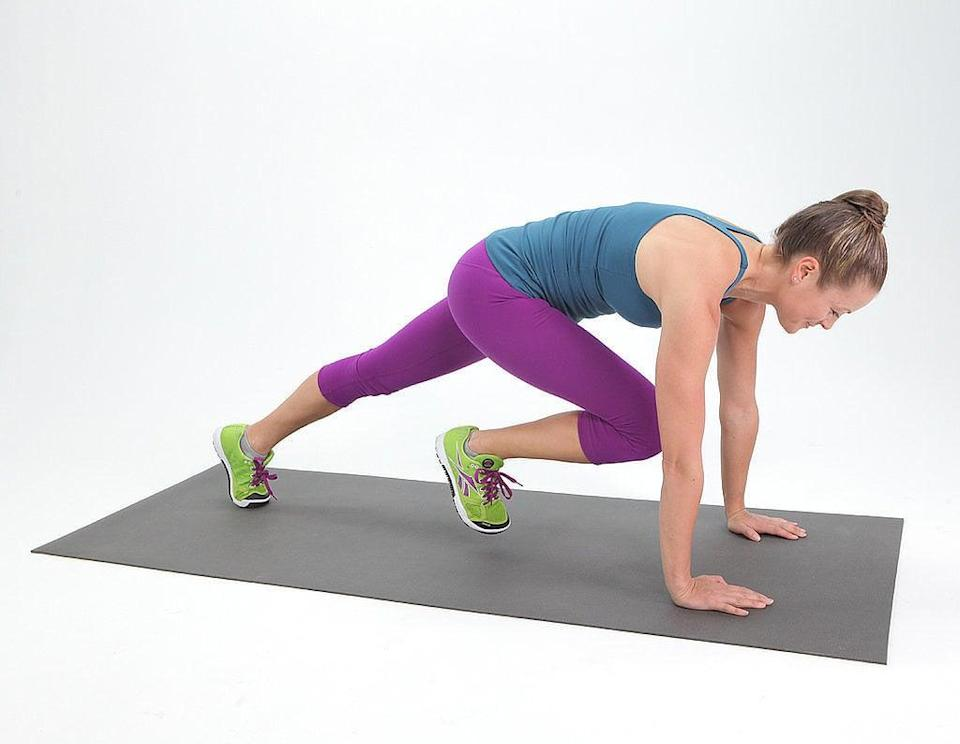 "<ul> <li>Start in a traditional plank with your shoulders over your hands and weight in your toes.</li> <li>With your core engaged, bring your right knee forward under your chest, with your toes just off the ground. Return to your basic plank. Switch legs, bringing your left knee forward.</li> <li>Keep switching legs and begin to pick up the pace until it feels a little like running in place in a plank position.</li> <li>Perform for 30 seconds.</li> </ul> <p>Click <a href=""https://www.popsugar.com/smart-living/Health-Wellness-Tips-46521311"" class=""link rapid-noclick-resp"" rel=""nofollow noopener"" target=""_blank"" data-ylk=""slk:here for more health and wellness stories, tips, and news"">here for more health and wellness stories, tips, and news</a>.</p>"