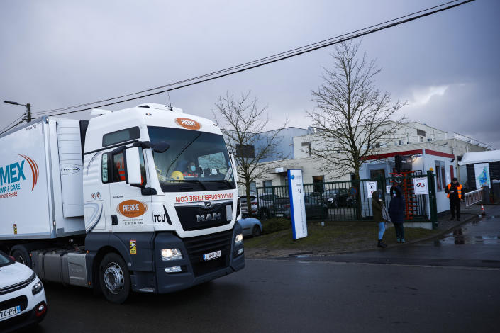 A truck leaves Novasep factory in Seneffe, Belgium, Friday, Jan. 29, 2021. Amid a dispute over expected shortfalls, the European Union is looking at legal ways to guarantee the delivery of all the COVID-19 vaccine doses it bought from AstraZeneca and other drugmakers as regulators are set to consider approving the Anglo-Swedish company's vaccine for use in the 27-nation EU. (AP Photo/Francisco Seco)