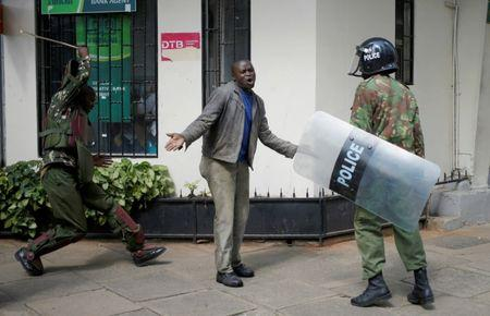 Kenyan policemen beat a protester during clashes in Nairobi, Kenya May 16, 2016. REUTERS/Goran Tomasevic/File Photo